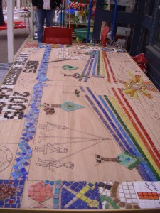 The mosaic takes shape and all pupils staff and Governers get involvd